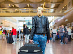 Generic_Woman_Caryying_Luggage_Airport_Transfer_41315725_ML