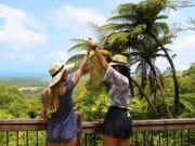 Alexandra Range Lookout two women raised hands
