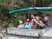 rainforestation nature park guide explaining