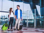 Airport_Asian-Couple-with-Luggage