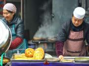 vendors preparing food xian morning market tour