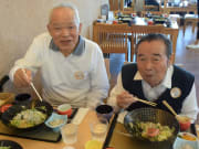 2 elderly men enjoying Japanese seafood