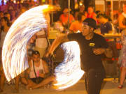 male performer fire show at the full moon party