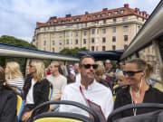 travelers aboard city sightseeing double decker