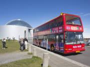 travelers visiting perlan glass dome in reykjavik