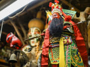 jiufen village puppet in red and green robe