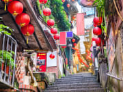 jiufen village staircase with red lanterns hanging