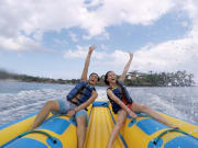 couple enjoying banana boat ride in indonesia