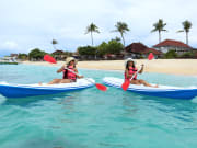 two women kayaking at nusa lembongan beach