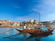 Portugal_Porto_boat_wine barrel_shutterstock_156924158