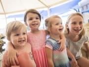 four kids enjoying aquarium of western australia