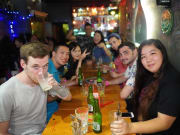 singapore pub crawl tourists at group table
