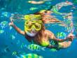Snorkeling Girl Underwater swimming with fish