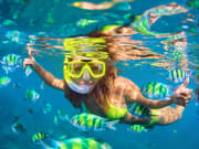 Snorkeling Girl Underwater swimming with fish