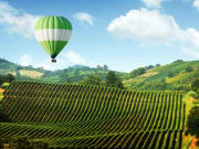 hot air balloon, rolling hills, tuscany
