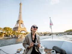 tourist, seine river cruise, eiffel tower backdrop