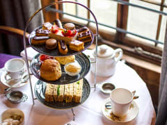 Tea sandwiches, pastries, cups