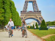 France_Paris_Eiffel tower_Couple_Riding_Bicycles_shutterstock_523499074