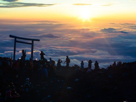 Japan_Yamanashi_Mt Fuji_Summit_Sunrise_Hiker_shutterstock_554773459