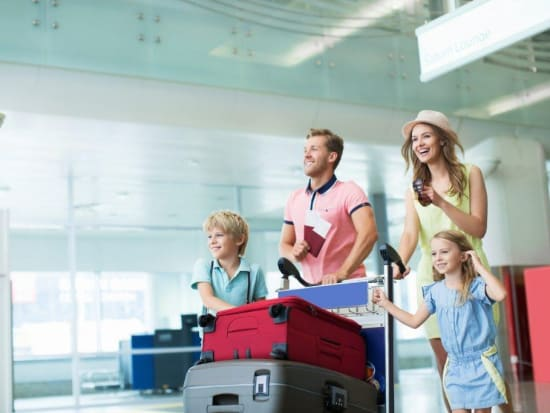 Generic_Airport_Transfer_Passenger_Family_Suitcase_Luggage_Shutterstock