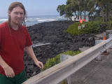 Me with surf board in background at starting location