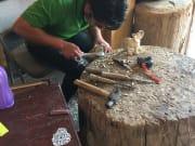 サン・マルティン・ティルカヘテ村の木彫り