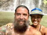 My wife and I in the pool at the base of the falls.